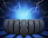 Wedge of new car wheels. Abstract background with lightning — Stock Photo