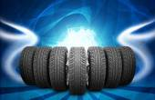 Wedge of new car wheels. Abstract background is lines and stripes at bottom — Stock Photo