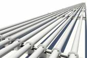 Industrial pipes stretching into distance — Stock Photo