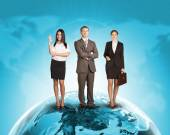 Business people in suit standing on Earth surface — Stock Photo