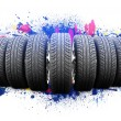 Seven new car wheels. Abstract background is colored blots — Stock Photo #69513977