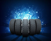 Wedge of new car wheels. Abstract blue background — Stock Photo