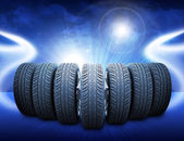 Wedge of car wheels. Abstract blue background — Stock Photo