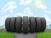 Wedge of new car wheels on road fork — Stock Photo