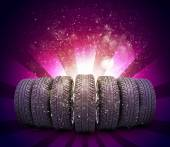Wedge of new car wheels. Abstract red background — Stock Photo