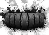 Wedge of new car wheels. Black blotches and gray stripes — Stock Photo