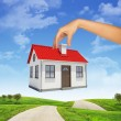Womans hand holding house for pipe — Stock Photo #71611967