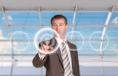 Businessman pressing on holographic screen — Stock Photo