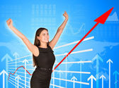 Young businesswoman with arms up — Stock Photo