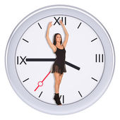 Young woman standing in center of clock  — Stock Photo