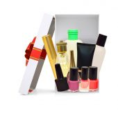 Open gift box with cosmetics on white — Stock Photo