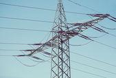 Electric poles on blue sky — Stock Photo