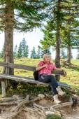 Resting woman on a wooden bench — Stock Photo