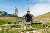 Wooden chapel in the alps — Stock Photo