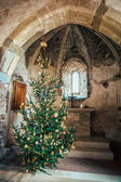Christmas tree in a medieval chapel — Stock Photo