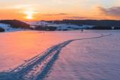 Scene with trail on snow at sunset background — Stock Photo