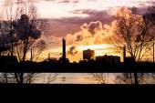 Factory with smokestacks at sunset — Stock Photo