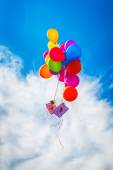 Colorful balloon on blue sky — Stock Photo