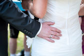 Mans hands hugging female booty, close-up — Stock Photo