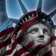 Double exposure image of the Statue of Liberty and the American flag — Stok fotoğraf #77039837