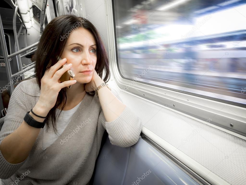 woman in her 30s is riding the subway ans looking out the window stock photo moussa81 77249224. Black Bedroom Furniture Sets. Home Design Ideas