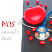 Stethoscope with red  pills and heart — Foto de Stock