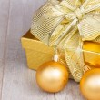 Golden  gift box with christmas decorations — Stock Photo #52860455