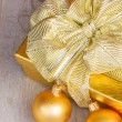 Golden  gift box with christmas decorations — Stock Photo #52862467