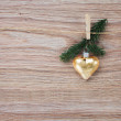 Christmas golden heart with evergreen twig — Stock Photo #53169581