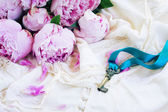 Key with peony flowers — Stock Photo