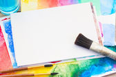 White canva with frame of paints and brushes — Stock Photo