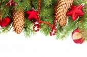 Fir tree with red christmas decorations and cones — Stock Photo