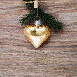 Christmas golden heart with green  twig — Stock Photo #54813893