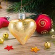 Golden heart on fir tree — Stock Photo #55392807