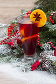 Mulled wine with decorated christmas tree — Stock Photo