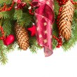 Fir tree with red christmas decorations and cones — Stock Photo #55912811