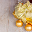 Golden  gift box with christmas decorations — Stock Photo #56483893