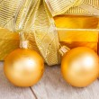 Golden  gift box with christmas decorations — Stock Photo #56484645