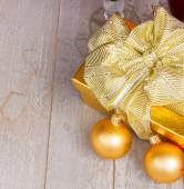 Golden  gift box with christmas decorations — Stock Photo