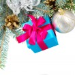 Blue fir tree with gift box — Stock Photo #57734445