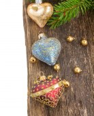 Christmas hearts on wooden background border — Stock Photo