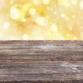 Wooden planks with golden bokeh background — Stock Photo