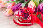 Bouquet of multicolored   tulip flowers with heart — Stock Photo
