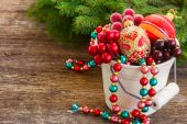 Pot with christmas decorations — Stock Photo