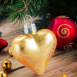 Golden heart on fir tree — Stock Photo #59301781