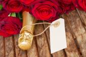 Dark red  roses with neck of champagne — Stock Photo