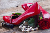 Red shoes with rose flower — Foto de Stock