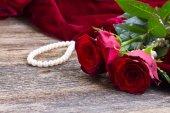 Red roses on velvet — Stock Photo