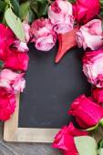 Red and pink  roses  frame on table — Stock Photo