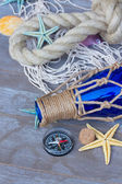 Compass on fishing net — 图库照片